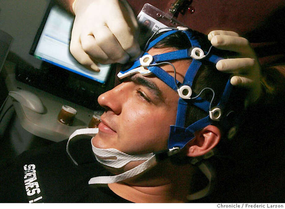 John Potter (25) a Marine vet gets a brain scan which helps gauge brain damage in veterans that where injured in the war in Iraq at the brain trauma center at the Palo Alto Veterans Administration Hospital. John Potter got his head injury in California in auto accident during duty. 6/27/06  {Frederic Larson/The Chronicle} **John Potter Ran on: 08-13-2006  Above: Iraq war vet John Potter in a driver training simulator; right, another vet, Angel Gomez, at the wheel. Photo: Frederic Larson