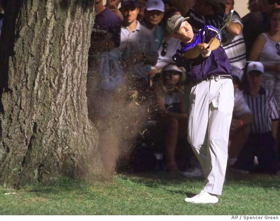 ** ADVANCE FOR WEEKEND EDITIONS, AUG. 11-14 ** FILE** Sergio Garcia, of Spain, takes a cut at his ball located at the base of a tree on the 16th hole during the final round of the PGA Championship at the Medinah Country Club in Medinah, Ill., on Aug. 15, 1999. Garcia's shot was the signature shot of the tournament, where the 19-year-old kid, was trying unsuccessfully to beat Tiger Woods for the championship. Garcia and the PGA Championship return to Medinah beginning Aug. 17. (AP Photo/M. Spencer Green) ** ADVANCE FOR WEEKEND EDITIONS, AUG. 11-14 ** A AUG. 15, 1999 FILE PHOTO Photo: M. SPENCER GREEN
