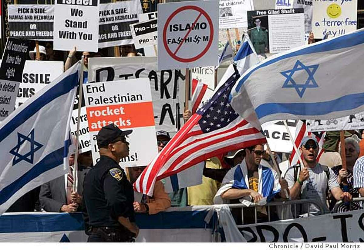 SAN FRANCISCO - AUG 12: Police monitor pro-Israel demonstrators on the steps of City Hall during a counter protest on August 12, 2006 in San Francisco, California. (Photo by David Paul Morris / The Chronicle)