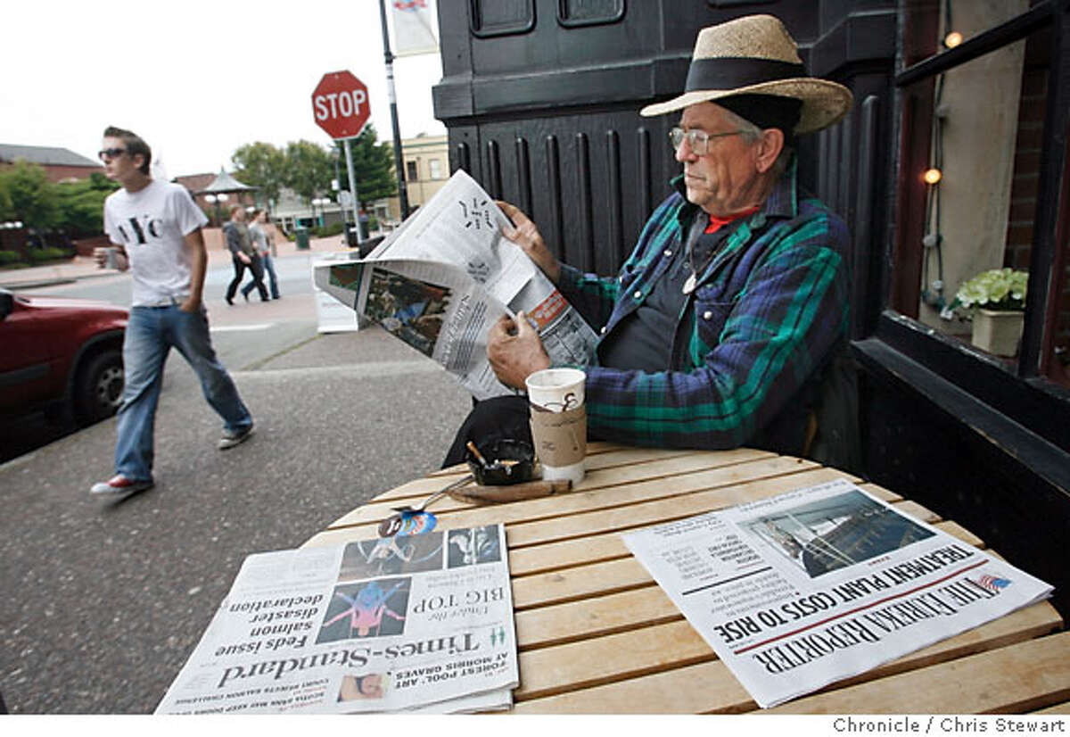 newspaperwar_587_cs.jpg Event on 7/8/06 in Eureka. Retired high school English teacher Terry Paul Larsen, 60, of Blue Lake, near Eureka, reads the competing local newspapers while having a coffee at the Old Town Coffee & Chocolates in Old Town Eureka. He called the Eureka Times-Standard �a dyslexic man�s nightmare. It leads with an issue and goes to small type, plus it has two scraggly trees on its masthead,� but likes the national news reported on A-1. His take on the Eureka Reporter: �The Reporter is a reaction to the Times-Standard, but has only local interests on its cover. I do like the gently waving flag on the cover.� Larsen sums up by saying, �The Times-Standard has the readership. The Reporter is trying to create a readership.� Eureka, county seat of scenic Humboldt County, is having a newspaper war. The battle has been joined between the venerable Eureka Times-Standard and the upstart Eureka Reporter. The 20,000-plus paid-circulation Times-Standard, managed by Dean Singleton's Denver-based MediaNews Group has been challenged by the upstart family owned Eureka Reporter, a free 22,000 circulation newcomer owned by Rob Arkley Jr., head of Security National Holding Company, a Eureka-based multibillion dollar national real estate owner and developer with offices in the U.S. and Europe. Chris Stewart / The Chronicle MANDATORY CREDIT FOR PHOTOG AND SF CHRONICLE/ -MAGS OUT