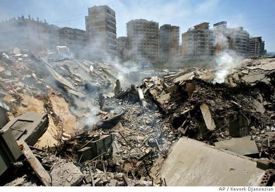 Smoke billows from a destroyed clothing factory, following an Israeli air strike early Friday, in the Hezbollah stronghold suburbs of Beirut, Lebanon, Saturday, Aug. 12, 2006. (AP Photo/Kevork Djansezian) Photo: KEVORK DJANSEZIAN