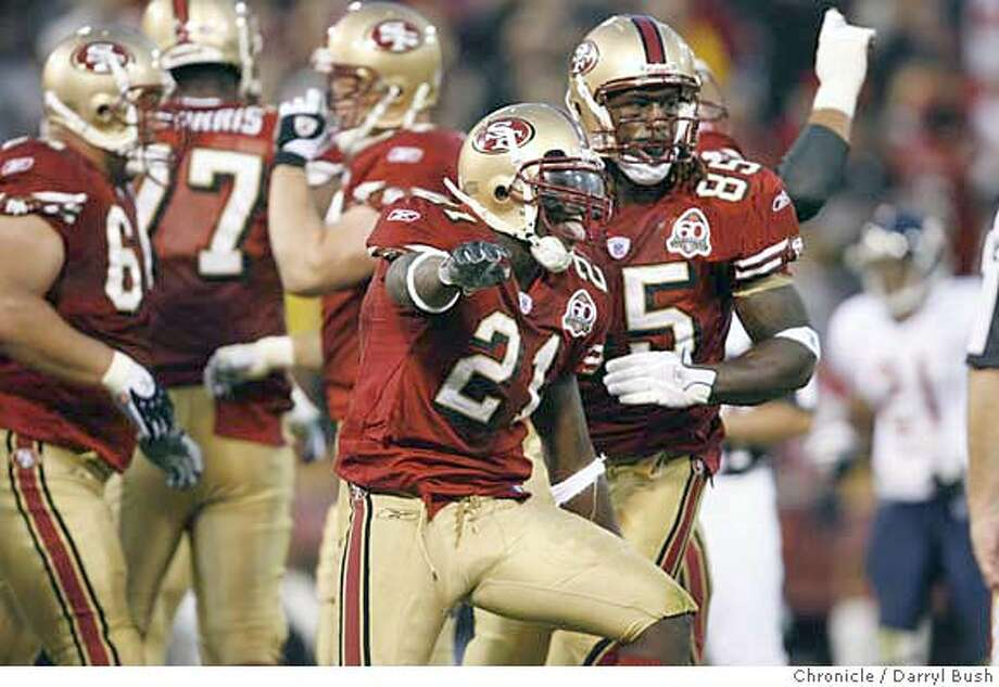 49ers_0004_db.JPG  49ers running back Frank Gore (21) celebrates his touchdown, with teammate Vernon Davis(85) back right, in the 2nd qtr. of the San Francisco 49ers vs. Chicago Bears game at Monster Park San Francisco, CA on Friday, August 11, 2006. 8/11/06  Darryl Bush / The Chronicle ** (cq) MANDATORY CREDIT FOR PHOTOG AND SF CHRONICLE/ -MAGS OUT Photo: Darryl Bush