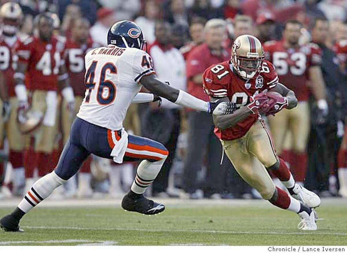 49ERS_0055.JPG 49ers 81 Antonio Bryant hauls in a Alex Smith first down pass in front of Bears 46 Chris Harris. San Francisco 49ers vs the Chicago Bears during preseason game at Monster Park in San Francisco.8/11/06 in SAN FRANCISCO. By Lance Iversen/San Francisco Chronicle MANDATORY CREDIT PHOTOG AND SAN FRANCISCO CHRONICLE/ MAGS OUT