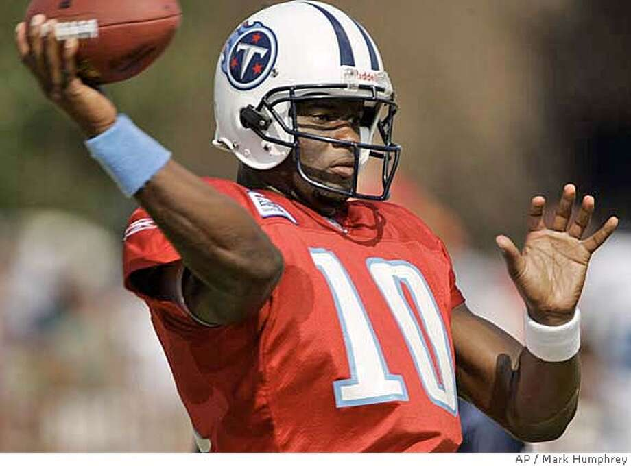 ** ADVANCE FOR WEEKEND EDITIONS, AUG. 5-7 ** Tennessee Titans rookie quarterback Vince Young throws with his unusual, slightly sidearm form during football training camp in Clarksville, Tenn. on Saturday, Aug. 5, 2006. The Titans elevated Young, the third pick overall, to backup quarterback when former starter Steve McNair was traded June 7. Young has taken at least 30 percent of the snaps through the first nine days of training camp, and he's worked occasionally with the first-team offense.(AP Photo/Mark Humphrey) Photo: MARK HUMPHREY