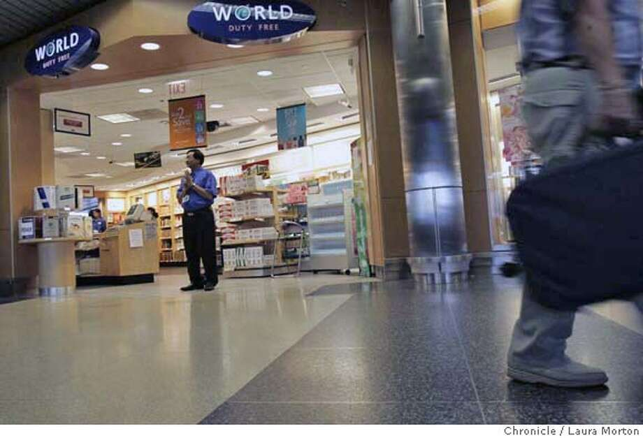 Ohare_13827_lkm.jpg Chicago's O'Hare Airport was busy Thursday afternoon, but the World Duty Free shop in terminal three was not. All liquid and gel items such as toothpaste and cosmetics were banned from carry-on items due to a heightened security alert caused by the foiled terrorist plot. Laura Morton/The Chronicle MANDATORY CREDIT FOR PHOTOGRAPHER AND SAN FRANCISCO CHRONICLE/ -MAGS OUT Photo: Laura Morton