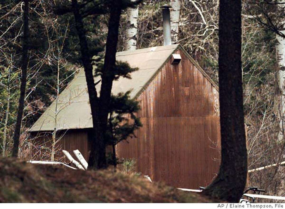 Theodore Kaczynski's cabin is shown in the woods of Lincoln, Mont., Saturday, April 6, 1996. The one-room residence continues to be searched by the FBI for evidence to link Kaczynski to the series of Unabomber bombings. (AP Photo/Elaine Thompson) ELECTRONIC IMAGE