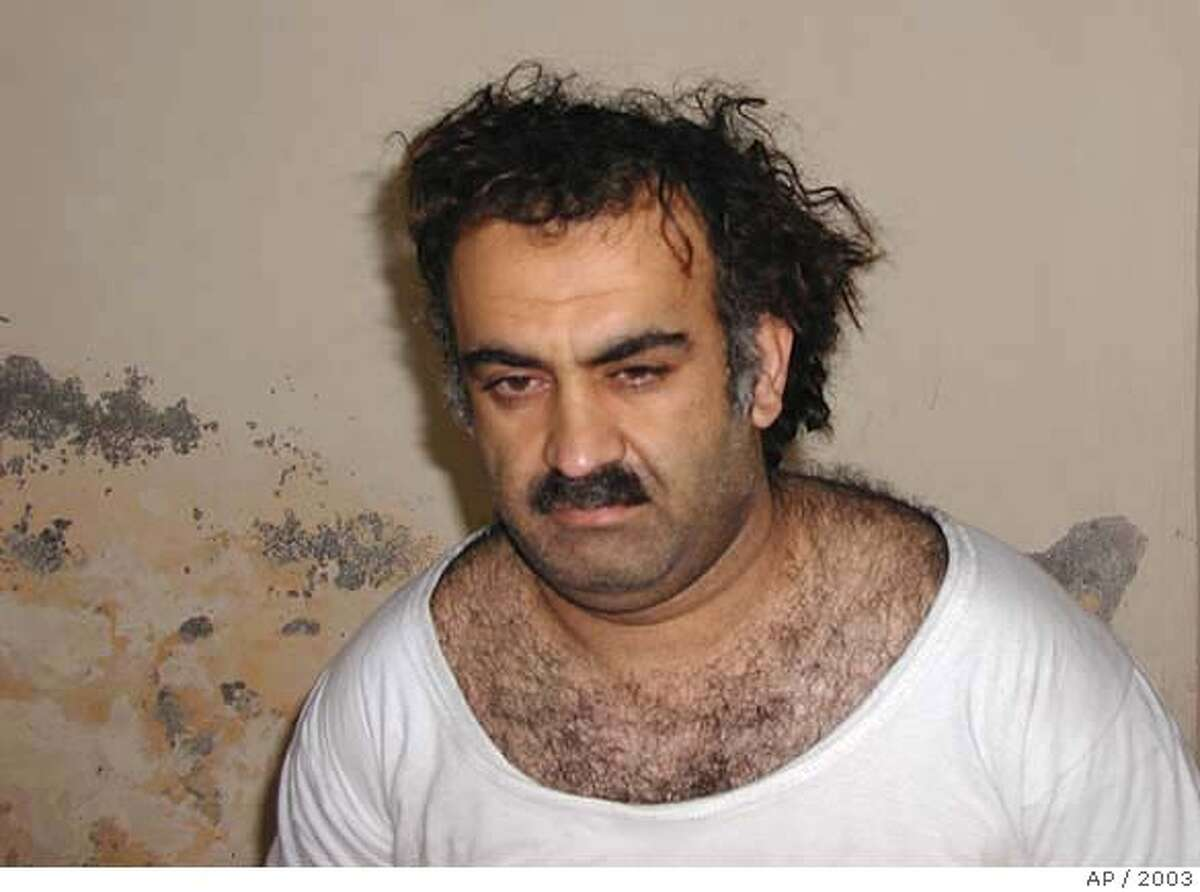 ** FILE ** Khalid Shaikh Mohammed, the alleged Sept. 11 mastermind, is seen shortly after his capture during a raid in Pakistan Saturday March 1, 2003 in this photo obtained by the Associated Press. (AP Photo) Ran on: 06-17-2004 FLIGHT NEARLY MISSED: Mohamed Atta (right) and Abdulaziz Alomari (center) were caught by a surveillance tape at the Portland, Maine, airport. They nearly missed connecting with the flight in Boston that they hijacked and crashed into the World Trade Center. Ran on: 06-17-2004 FLIGHT NEARLY MISSED: Mohamed Atta (right) and Abdulaziz Alomari (center) were caught by a surveillance tape at the Portland, Maine, airport. They nearly missed connecting with the flight in Boston that they hijacked and crashed into the World Trade Center. Ran on: 06-17-2004 CLOSE CALL Mohamed Atta (right) and Abdulaziz Alomari (center) were caught by a surveillance tape at the Portland, Maine, airport. They nearly missed connecting with the flight in Boston that they hijacked and crashed into the World Trade Center. Ran on: 12-17-2004 Khalid Sheikh Mohammed, left, and Ramzi Binalshibh, alleged Sept. 11 plotters, are believed to be held by the CIA at undisclosed locations. Ran on: 11-24-2005 Ran on: 11-24-2005