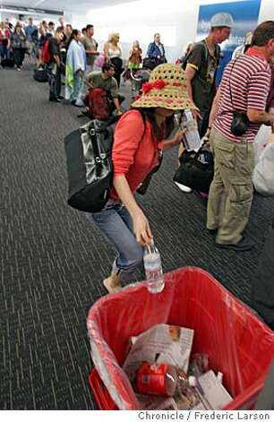 At SFO air travelers like Sanae Muranaka going to Hawaii had to dumped their water bottles, tossed their suntan lotion and waited hours in ever lengthening lines Thursday morning as airports ratcheted up security and delayed flights after authorities uncovered a terror plot in Britain.  In major U.S. airports, guards armed with rifles stood at security checkpoints and passengers were met by signs warning that all liquids were now banned from carry-on luggage. In one terminal at Baltimore/Washington International Thurgood Marshall Airport, security workers opened every carry-on bag and all the flights were delayed.  8/10/06  {Frederic Larson/The Chronicle} Photo: Frederic Larson