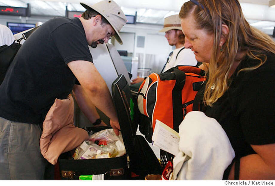 Michael and Meri (CQ) Thwaites of El Cerrito move liquids from their carry-on luggage to their check-in bags before checking in for their Delta Flight to Orlando Florida. After a large scale terrorist threat was thwarted in London today, airline passengers arrived at the Oakland International airport which is on Orange alert, to find new security measures, absolutely no liquids alowed in carry-on luggages (this includes deodorant, toothpaste, and lipsticks in Oakland Thursday August 10, 2006 Kat Wade/The Chronicle ** Michael and Meri (CQ) Thwaites (Subject) cq Photo: Kat Wade