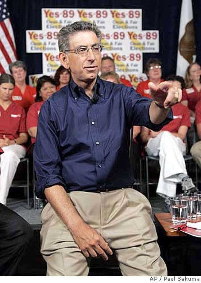 California Democratic gubernatorial candidate Phil Angelides gestures at a rally at the California Nurses Association offices in Oakland, Calif., Thursday, Aug. 3, 2006. Angelides on Thursday endorsed the campaign finance-reform initiative, Proposition 89, on the November ballot. The initiative, sponsored by the CNA, would limit campaign contributions and authorize public financing for state candidates. (AP Photo/Paul Sakuma) Photo: PAUL SAKUMA