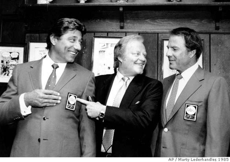 """** FILE ** Joe Namath, left, Roone Arledge, center, pointing to Namath's sports coat logo, and Frank Gifford pose at a news conference at the """"21 Club in New York after announcing that Namath will join the crew of """"Monday Night Football, """" in this July 9, 1985 photo. Arledge, a pioneering television executive at ABC News and Sports responsible for creating shows from ``Monday Night Football'' to ``Nightline,'' died Thursday, Dec. 5, 2002 at Memorial Sloan-Kettering Cancer Center in New York, an ABC News spokesman said. He was 71."""" (AP Photo/Marty Lederhandler) CAT A July 9, 1985 file photo Photo: MARTY LEDERHANDLER"""