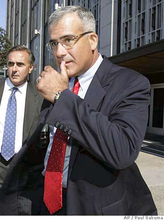 Gregory L. Reyes, former CEO of Brocade Communications Systems Inc. leaves a federal courthouse in San Francisco, Wednesday, Aug. 2, 2006. Reyes and Stephanie Jensen, former vice president of human resources for Brocade, posted bond on charges relating to stock options issued. According to the criminal complaints, Reyes and Jensen authorized options grants with exercise prices that were below the price of Brocade's stock on the day they were issued, giving the recipients an immediate paper profit. (AP Photo/Paul Sakuma) Photo: PAUL SAKUMA