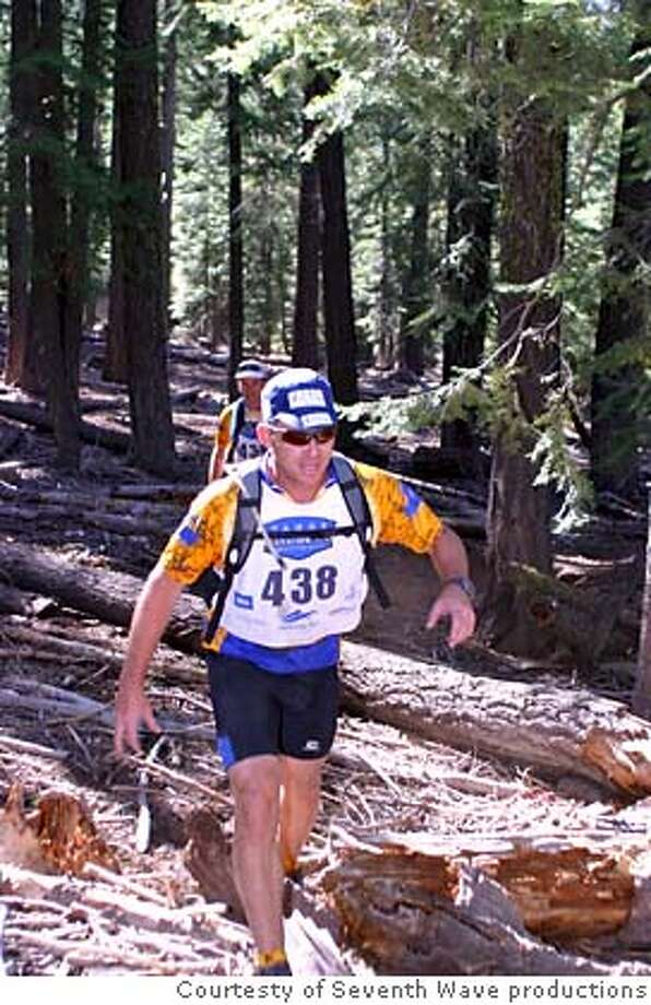 Entrants in the Big Blue Series adventure race at Lake Tahoe course through an Alpine forest.  FOR: Outdoors/Sports for 8/10/2006. Credit: Courtesty of Seventh Wave productions Photo: Courtesty Of Seventh Wave Produc
