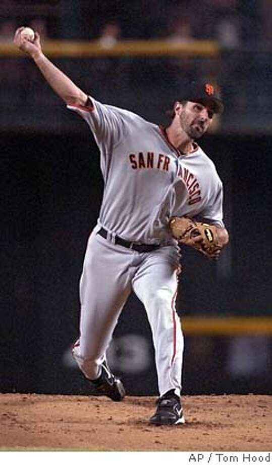 San Francisco Giants starting pitcher Matt Morris delivers during the second inning of the Giants baseball game against the Arizona Diamondbacks Wednesday, Aug. 9, 2006 in Phoenix. (AP Photo/Tom Hood) Photo: TOM HOOD