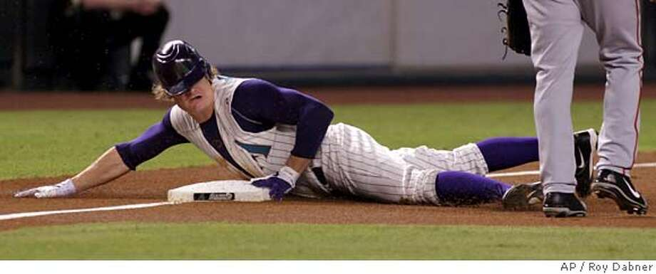 Arizona Diamondbacks center fielder Eric Byrnes looks back to find that he was way ahead of the throw, as he hits a triple off San Francisco Giants Jamey Wright, to lead off their baseball game, Tuesday, Aug. 8, 2006, in Phoenix.(AP Photo/Roy Dabner) Photo: ROY DABNER