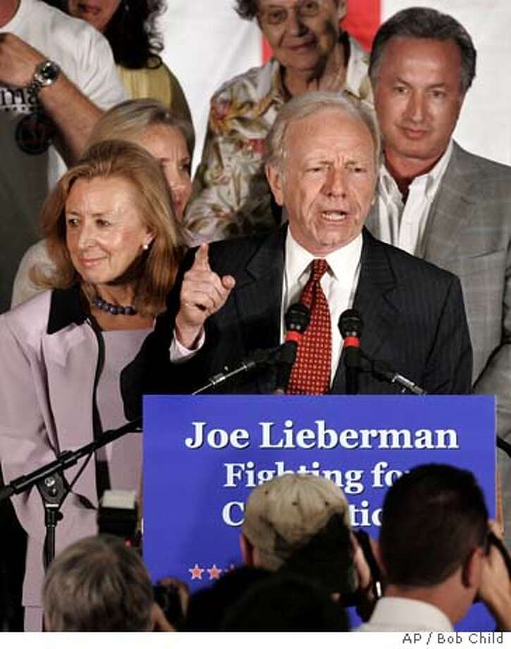 Incumbent party-endorsed Democratic U.S. Sen. Joseph I. Lieberman makes a point as he spoke in Hartford, Conn., Tuesday, Aug. 8, 2006 after he was defeated in a primary by Ned Lamont. Lieberman said he would run as an independent. His wife Hadassah is at left. (AP Photo/Bob Child) Photo: BOB CHILD