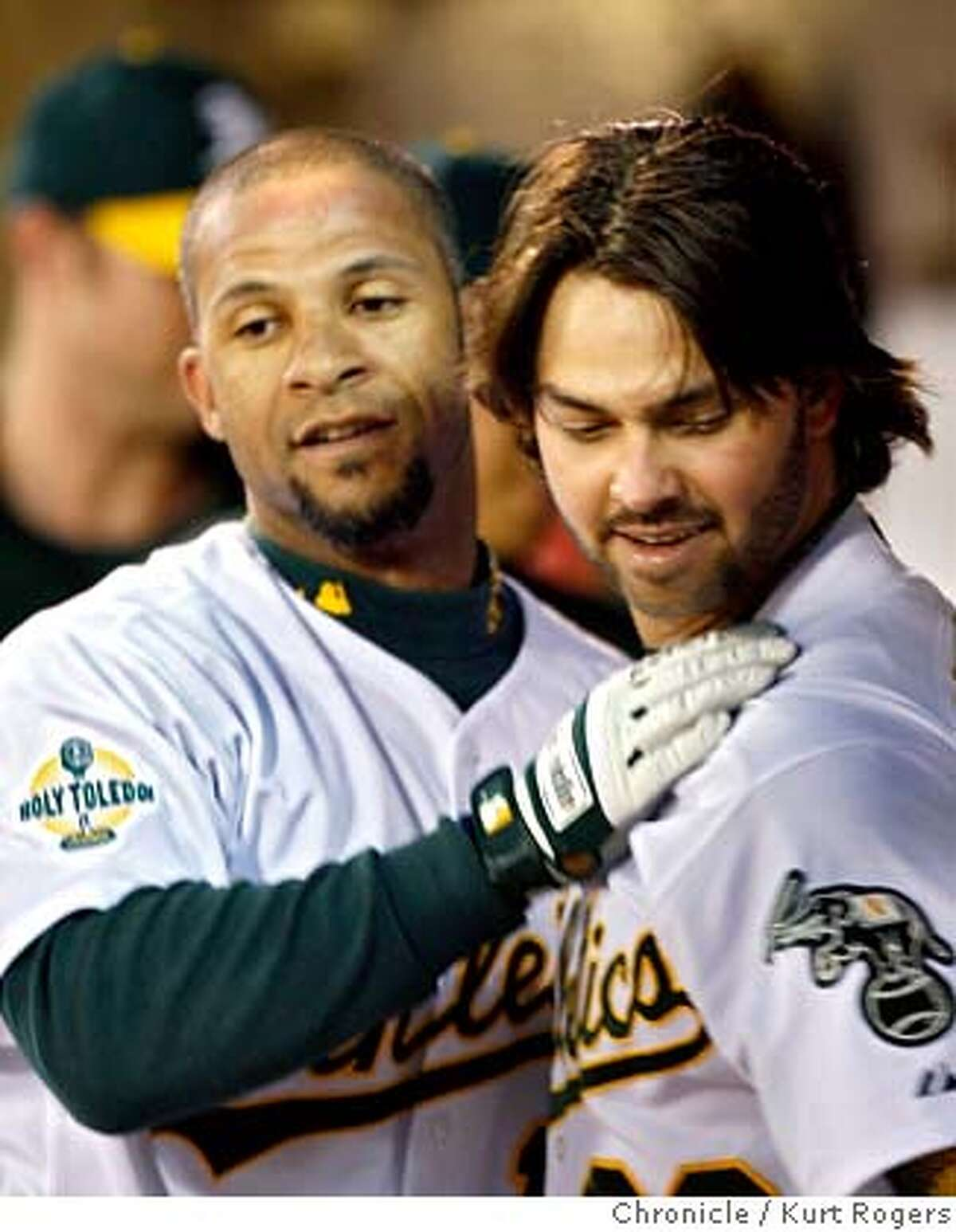 Jay Payton and Marco Scutaro congradulate each other on there home runs in the 4th to tie the game at 4. Texas Rangers vs Oakland Athletics at The McAfee coliseum in Oakland . KURT ROGERS/THE CHRONICLE OAKLAND THE CHRONICLE SFC