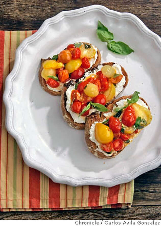 HEIRLOOM_050_CAG.JPG  Bruschetta with Fresh Ricotta and Cherry Tomatoes.  Photo by Carlos Avila Gonzalez/The San Francisco Chronicle  Photo taken on 8/1/06, in San Francisco, Ca, USA  **All names cq (source) MANDATORY CREDIT FOR PHOTOG AND SAN FRANCISCO CHRONICLE/ -MAGS OUT Photo: Carlos Avila Gonzalez
