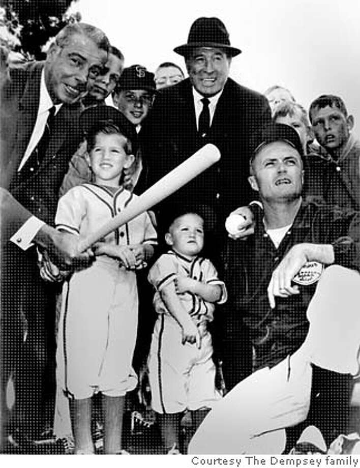 "DEMPSEY_OBIT_002_ho.jpg  Obit photo of Con Dempsey.  Men, left to right: Joe DiMaggio, ""Lefty"" O'Doul and Con Dempsey. Children, left to right: Con Dempsey, Jr, David Dempsey. Photo taken in 1966  Photo courtesy the Dempsey family. Photo: Courtesy Of Dempsey Family"