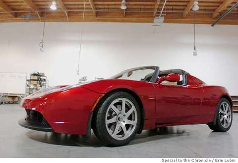 A Tesla Roadster Electric Sports Car Sits At The Motor Company Headquarters In San Carlos