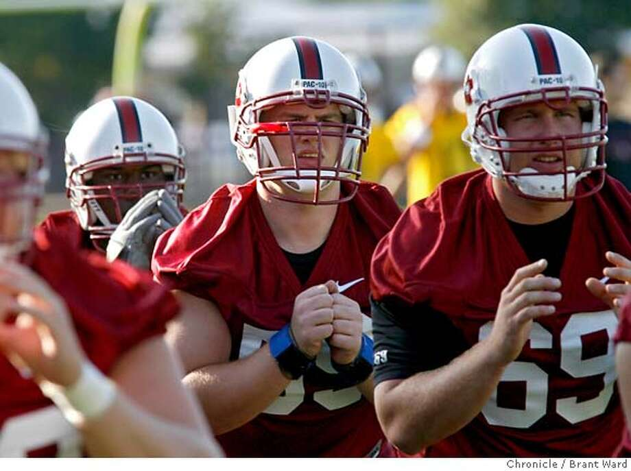stanford043.jpg  Offensive guard Josiah Vinson, center, worked out with other members of the offensiveline Monday.  Stanford football held their first practice Monday as they get ready for another Pac 10 season.  {Brant Ward/The Chronicle} 8/7/06 MANDATORY CREDIT FOR PHOTOGRAPHER AND SAN FRANCISCO CHRONICLE/ -MAGS OUT Photo: Brant Ward