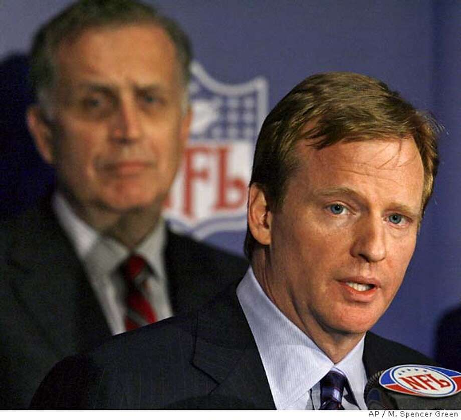Roger Goodell, right, the NFL's chief operating officer talks to the media after being selected to succeed Paul Tagliabue, left, as the league's commissioner Tuesday, Aug. 8, 2006 at an NFL meeting in Northbrook Ill. Goodell will assume the duties of commissioner when Tagliabue officially retires prior the the start of this year's regualr NFL season. (AP Photo/M. Spencer Green) Photo: M. SPENCER GREEN