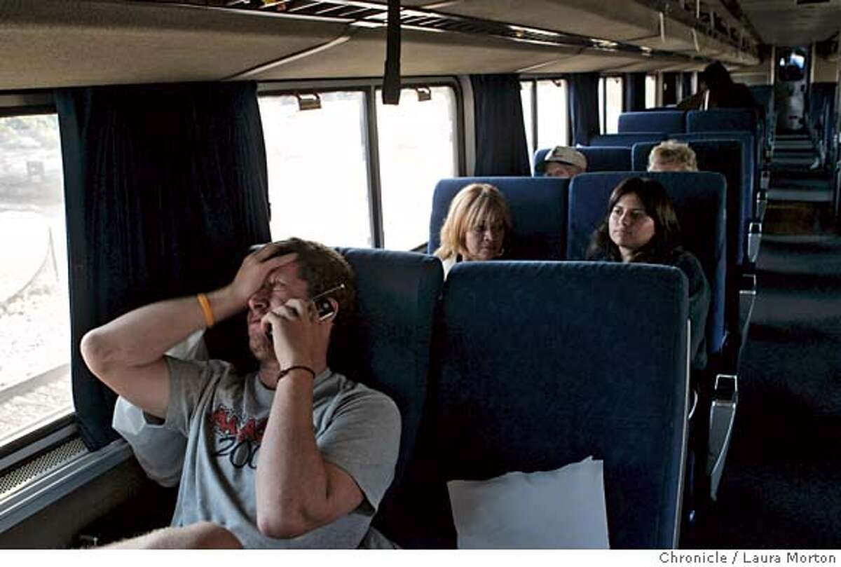 starlight_12636_lkm.JPG Ariel Mentez (left) talks to a friend on the phone about the problems he encountered while riding Amtrak's Coast Starlight train from Klamath Falls, OR to San Jose, CA. Mentez had to sleep in the train station the night before because the train didn't arrive at Klamath Falls until 2:50 a.m., which was several hours behind schedule.