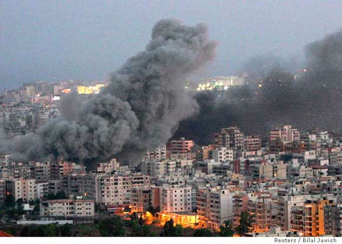 Smoke billows from buildings after a morning Israeli air raid on Beirut