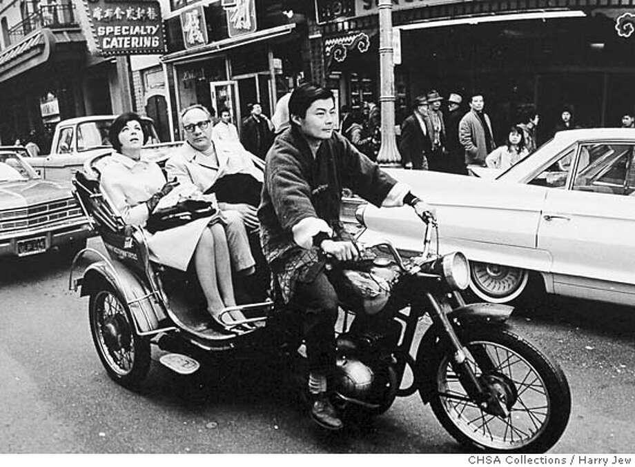 132-Tourism.1960s.jpg  CAPTION: Tourism Along Grant Avenue, 1960s.  CREDIT: Photograph by Harry Jew, CHSA Collections.  APPEARS: page 93 Photo: Photograph By Harry Jew, CHSA