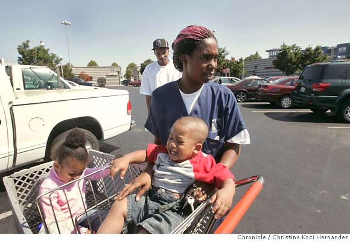 At Pak-n-Save in Emeryville, mother, Danika Price (cq) puts son, Deonte Johnson, 18 months in cart, with daughter already in back of cart, Deanna Johnson,4, as father of kids, Donte Johnson, walks behind.The nation�s pediatricians plan to warn parents Monday to stop letting their children ride in shopping carts because more than 24,000 kids were injured in them last year, mostly in falls or when a cart tipped over.(CHRISTINA KOCI HERNANDEZ/THE CHRONICLE) *Danika Price, Donte Johnson, Deonte and eanna Johnson (all cq) Mandatory Credit For Photographer and San Francisco Chronicle/No-Sales-Mags Out