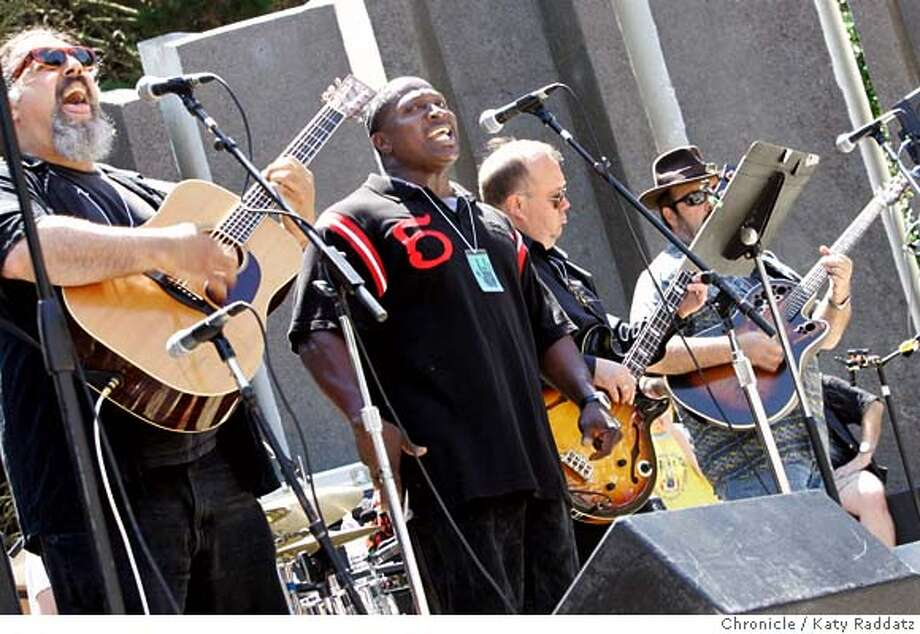 "GARCIA_034_RAD.jpg  SHOWN: A great local band, Django Obscura, from San Francisco entertains the crowd at ""Jerry Day"", celebrated (where else?) at the Jerry Garcia Ampitheater in McLaren Park in San Francisco. The Excelsior District in San Francisco is where Jerry Garcia grew up, and residents throw this annual free event to celebrate Jerry Garcia, and the naming of the ampitheater for him. These photos shot in San Francisco, CA. on Sunday August 6, 2006.  Photo taken on 7/26/06, in San Francisco, CA.  (Katy Raddatz/The S.F.Chronicle)  ** Mandatory credit for photographer and the San Francisco Chronicle/ -Mags out Photo: Katy Raddatz"