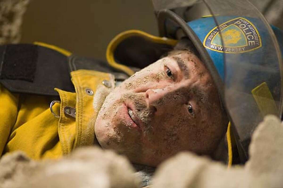 Photo credit: Fran�ois Duhamel In �World Trade Center,� Academy Award�-winning director Oliver Stone tells the true story of the heroic survival and rescue of two Port Authority policemen � John McLoughlin (Nicolas Cage, pictured) and Will Jimeno � who were trapped in the rubble of the World Trade Center on September 11, 2001, after they went in to help people escape. Paramount Pictures presents a Michael Shamberg/Stacey Sher/Moritz Borman Production, an Oliver Stone film, �World Trade Center.� Directed by Oliver Stone from a screenplay written by Andrea Berloff based on the true life events of John & Donna McLoughlin and William & Allison Jimeno, the film is produced by Michael Shamberg, Stacey Sher, Moritz Borman, and Debra Hill. Executive producers are Donald J. Lee, Jr. and Norm Golightly. The film is rated PG-13 for intense and emotional content, some disturbing images, and language.