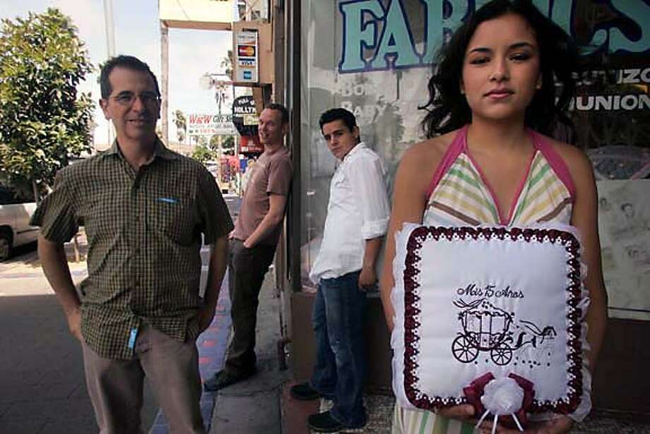 �Quincea�era� stars (from right) Emily Rios and Jesse Garcia with co-directors Wash Westmoreland and Richard Glatzer in the Mission. Chronicle photo by Liz Hafalia