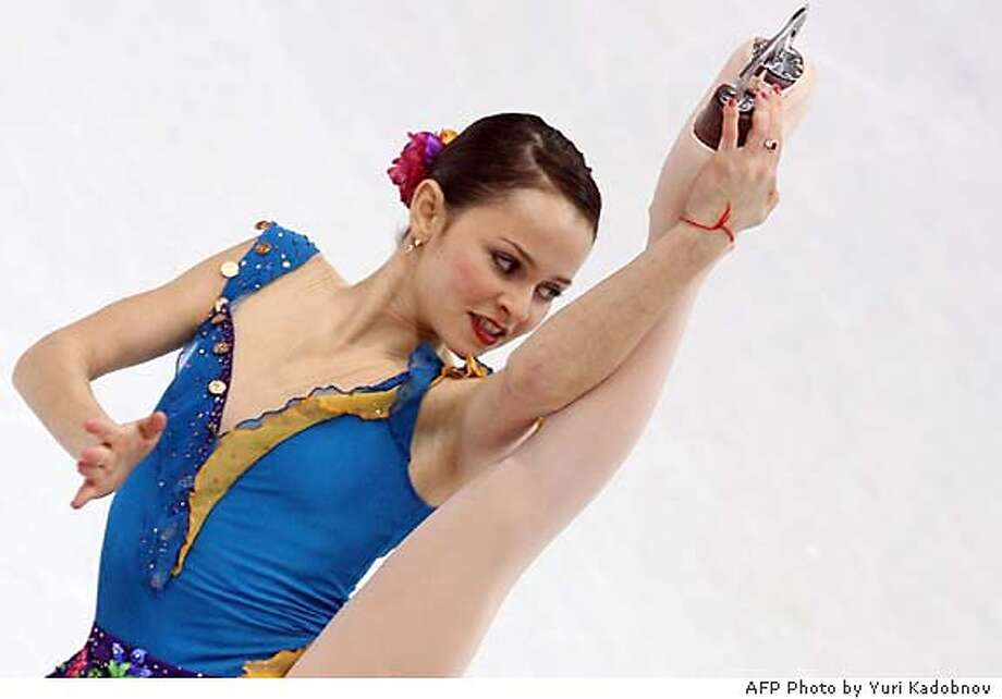 US Sasha Cohen performs in the Ladies short program during the Figure Skating competition at the 2006 Winter Olympics, 21 February 2006 at the Palavela in Turin. AFP PHOTO YURI KADOBNOV (Photo credit should read YURI KADOBNOV/AFP/Getty Images)Ran on: 02-22-2006  Photo caption Ran on: 02-22-2006  Photo caption DV Photo: YURI KADOBNOV
