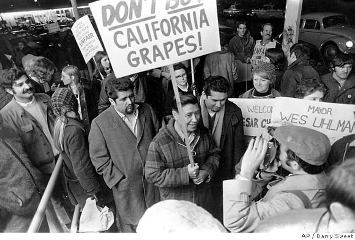 United Farm Workers President Cesar Chavez, carrying a sign calling for a boycott of California table grapes, leads about 400 people picketing a Safeway supermarket in Seattle, Wash., Dec. 19, 1969. (AP Photo/Barry Sweet) Ran on: 05-07-2006 Cesar Chavez (center with sign) fights in Seattle for the rights of immigrant workers. Ran on: 05-07-2006 Cesar Chavez (center with sign) fights in Seattle for the rights of immigrant workers.
