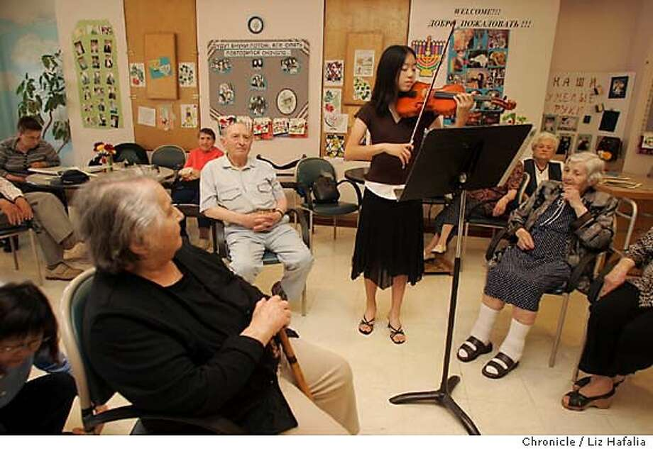 JA_CHAN_002.JPG Taylor Chan won the Jefferson award for her work with seniors with Alzheimers. She is 13-years-old and volunteers her time at the Institute On Aging in San Francisco playing music for the elderly. She is at the Russian speaking program of the institute playing Partita number 3 from Bach. Clockwise--(only allowed first names only) Gita, Abram, Taylor Chan (playing violin), Zelda, and Fira. Liz Hafalia/The Chronicle MANDATORY CREDIT FOR PHOTOGRAPHER AND SAN FRANCISCO CHRONICLE/ -MAGS OUT Photo: Liz Hafalia
