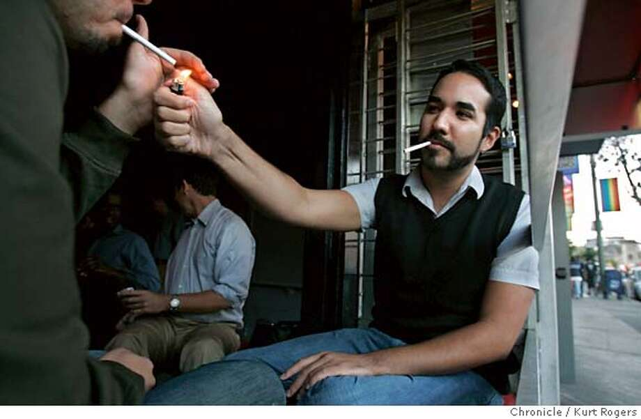 Javier Morelos 28 years old of San Francisco lights Gary Covrad's 26 of SF cigarette at The Bar on Castro St.  The high prevelance of smoking among gays and lesbians (they smoke at a rate twice the state average. KURT ROGERS/THE CHRONICLE SAN FRANCISCO THE CHRONICLE  SFC SMOKING06_0023_kr.jpg MANDATORY CREDIT FOR PHOTOG AND SF CHRONICLE / -MAGS OUT Photo: KURT ROGERS/THE CHRONICLE