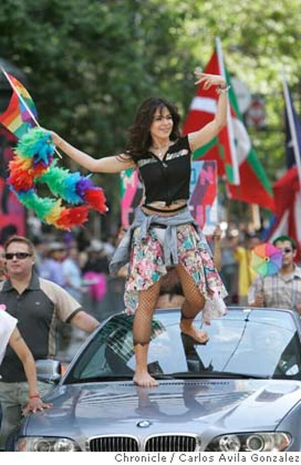 prideparade26010_cag.jpg  Mexican singer, Gloria Trevi, dances on the hood of her car for the crowd at the Gay Pride Parade in San Francisco, Ca., on Sunday, June 25, 2006. 36th Annual Gay Parade Photographed in San Francisico Carlos Avila Gonzalez/The Chronicle  All names cq (source) MANDATORY CREDIT FOR PHOTOG / Photo: Carlos Avila Gonzalez