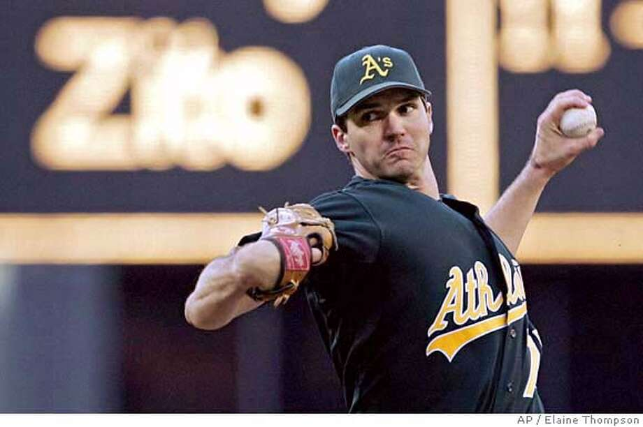 Oakland Athletics starting pitcher Barry Zito throws against the Seattle Mariners in the first inning in a baseball game, Friday, Aug. 4, 2006, in Seattle. (AP Photo/Elaine Thompson) Photo: ELAINE THOMPSON