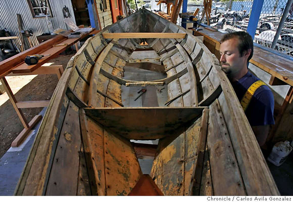 ARTCRAFT-BOAT_072_CAG.TIF Jody Boyle begins to reinforce the hull of a 16-foot boat that needs restoration at North Bay Boatworks in Sausalito, Ca., on Monday, July 31, 2006. Flying in the face of a tide of mediocrity, Sausalito�s North Bay Boat Works makes ocean-going vessels the old fashioned way by painstakingly handcrafting them from wood one at a time. �It�s a connection to materials and a way of working which our world today doesn�t really support,� says Jay Virok, 27, one of North Bay Boat Works founders. The group�s �unofficial� spokesman � �I don�t shy away when the microphone comes out� � and a passionate yet even keeled proponent of traditional wooden boat building, Virok can be very persuasive. Photo by Carlos Avila Gonzalez/The San Francisco Chronicle Photo taken on 7/31/06, in Sausalito, Ca, USA **All names cq (source) MANDATORY CREDIT FOR PHOTOG AND SAN FRANCISCO CHRONICLE/ -MAGS OUT