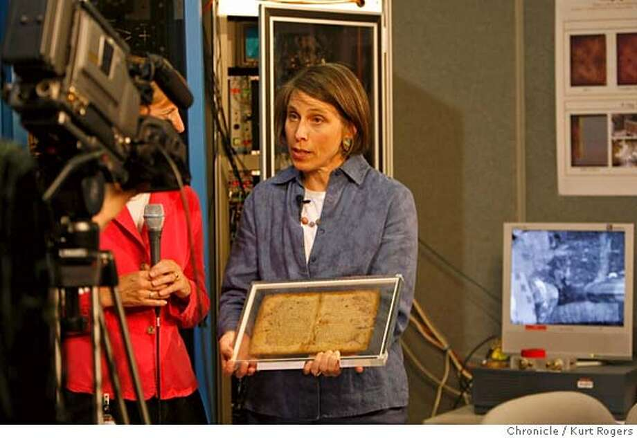 Abigail Quandt, head of book and paper conservation at the Walters Art Museum in Baltimore shows a page from Archimedes writing to an internet audience .the page was scanned two days ago by the stanford accelerator's x-ray beam.  They were on a live webcast scanning a new page for the audience. KURT ROGERS/THE CHRONICLE STANFORD THE CHRONICLE  SFC ARCHIMEDES03_0031_kr.jpg MANDATORY CREDIT FOR PHOTOG AND SF CHRONICLE / -MAGS OUT Photo: KURT ROGERS/THE CHRONICLE