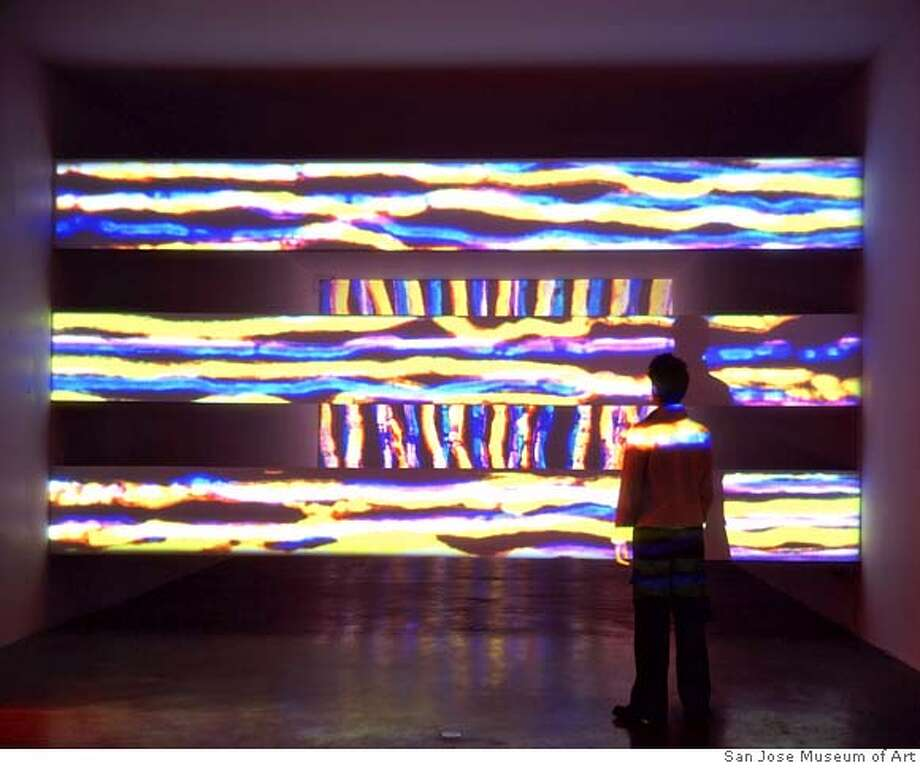 """""""TV Room"""" (1995) computer animation, video projection by Jennifer Steinkamp with soundtrack by Andrew Bucksburg Courtesy of the San Jose Museum of Art Photo: San Jose Museum Of Art"""