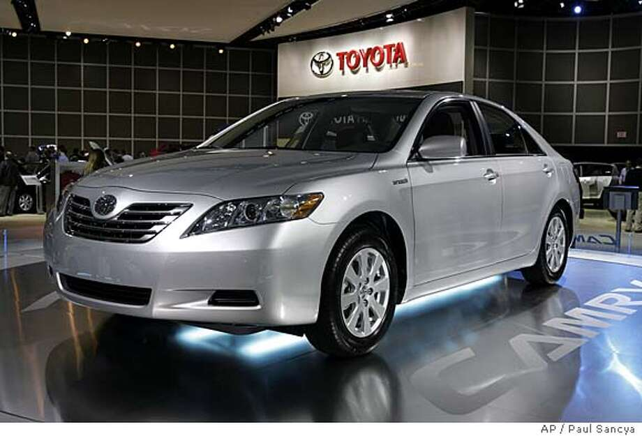 A 2007 Toyota Camry Hybrid is shown during industry preview day at the North American International Auto Show in Detroit, Wednesday, Jan. 11, 2006. Automakers introduced everything from a $120,000 pickup to a $14,000 subcompact at this year's North American Auto Show. Now, all they can do is sit back and see which vehicles will sell. Industry analysts say several should be hot sellers when they hit the market this year. Among them is the Camry, an update of the best-selling car in America, the 2007 Chevrolet Tahoe sport utility vehicle and the Honda Fit, a $14,000 subcompact that goes on sale this spring. (AP Photo/Paul Sancya)  Ran on: 07-16-2006 Ran on: 07-16-2006 Ran on: 07-16-2006 Ran on: 08-04-2006  Toyota boosted the Camry Hybrid's four-cylinder engine from 160 to 192 horsepower and still managed significant fuel savings in the large and roomy sedan.  Ran on: 08-04-2006 Ran on: 08-04-2006 Ran on: 08-04-2006 Photo: PAUL SANCYA