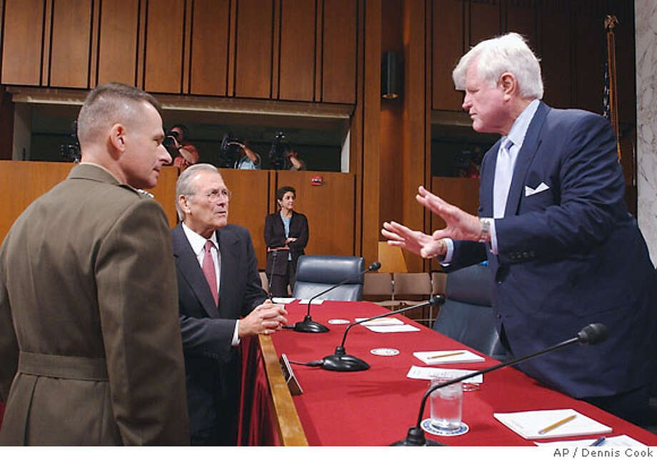 Senator Edward Kennedy, D-Mass., right, confers with Defense Secretary Donald Rumsfeld prior to a Senate Armed Services Committee in Washington, Thursday, Aug. 3, 2006. Chairman of the Joint Chiefs of Staff Gen. Peter Pace is at left. (AP Photo/Dennis Cook) Photo: DENNIS COOK
