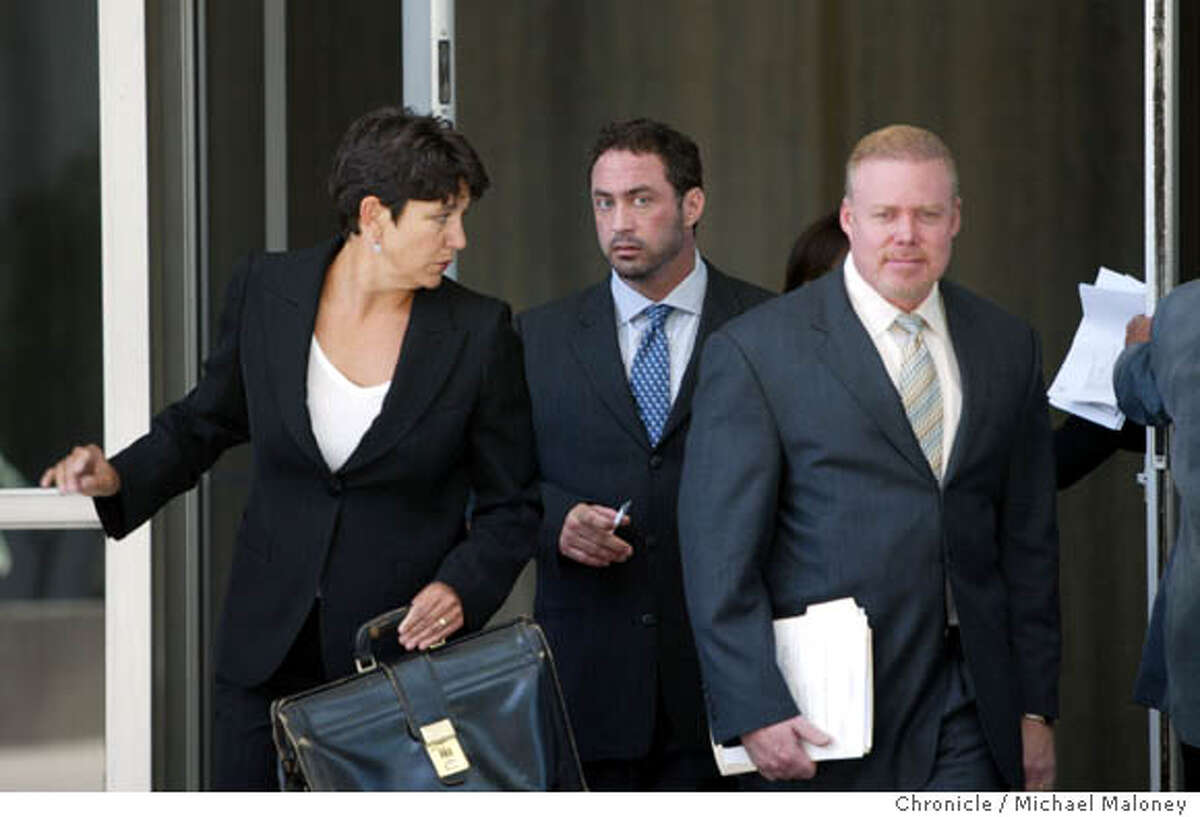 Patrick Arnold (center) leaves the Federal Building after his sentencing. With him are his lawyers Nanci (cq) Clarence and at right, Rick Collins. Chemist Patrick Arnold, a chemist found guilty in the BALCO case for distributing steroids appeared before a federal judge this morning for sentencing at the Federal Building in San Francisco. He was sentenced to 3 months in prison and 3 months house arrest. Photo by Michael Maloney / San Francisco Chronicle on 8/4/06 in SAN FRANCISCO,CA