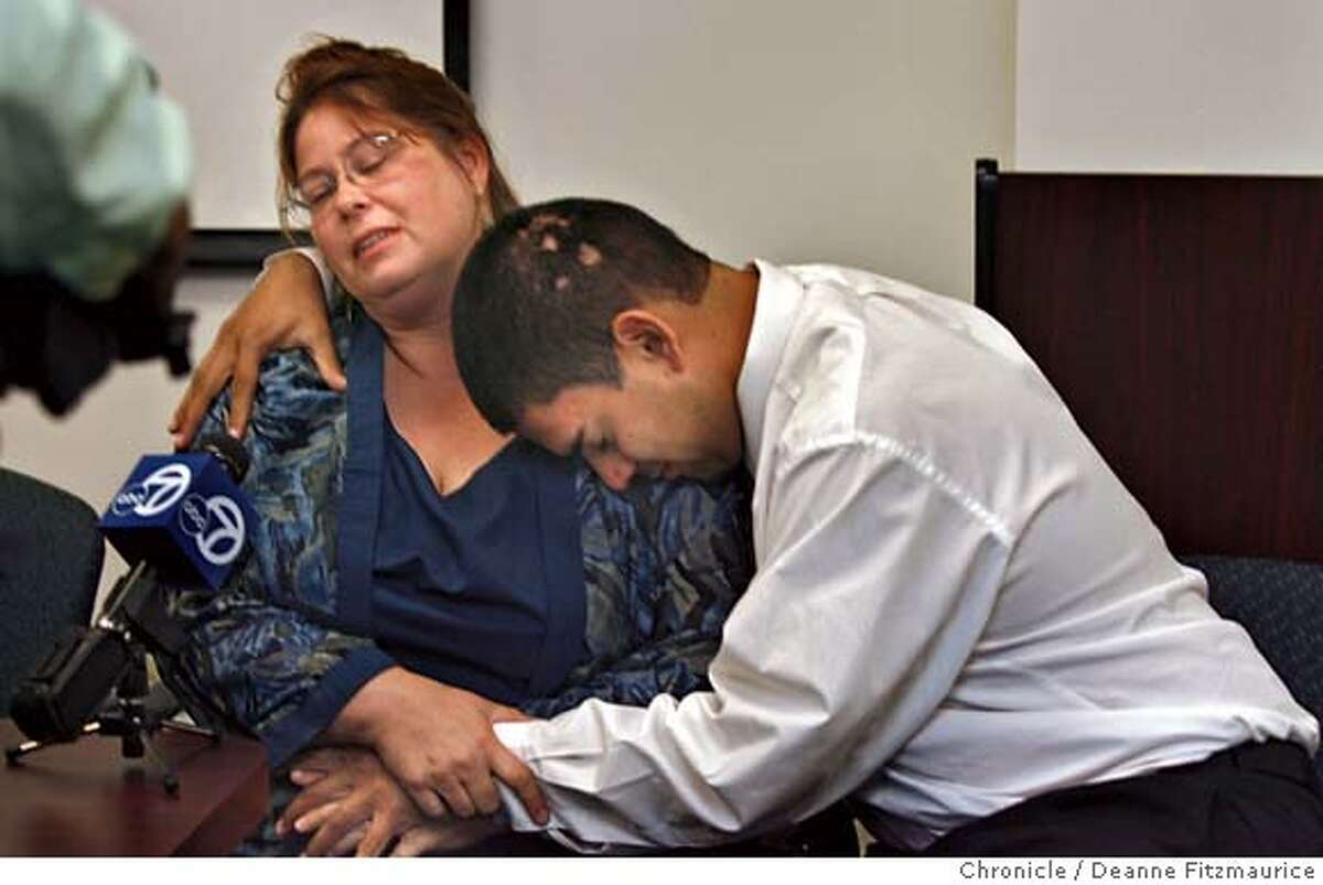 Asa Sullivan's mother, Kathleen Espinosa is comforted by her husband, Nelson Espinosa at a press conference.