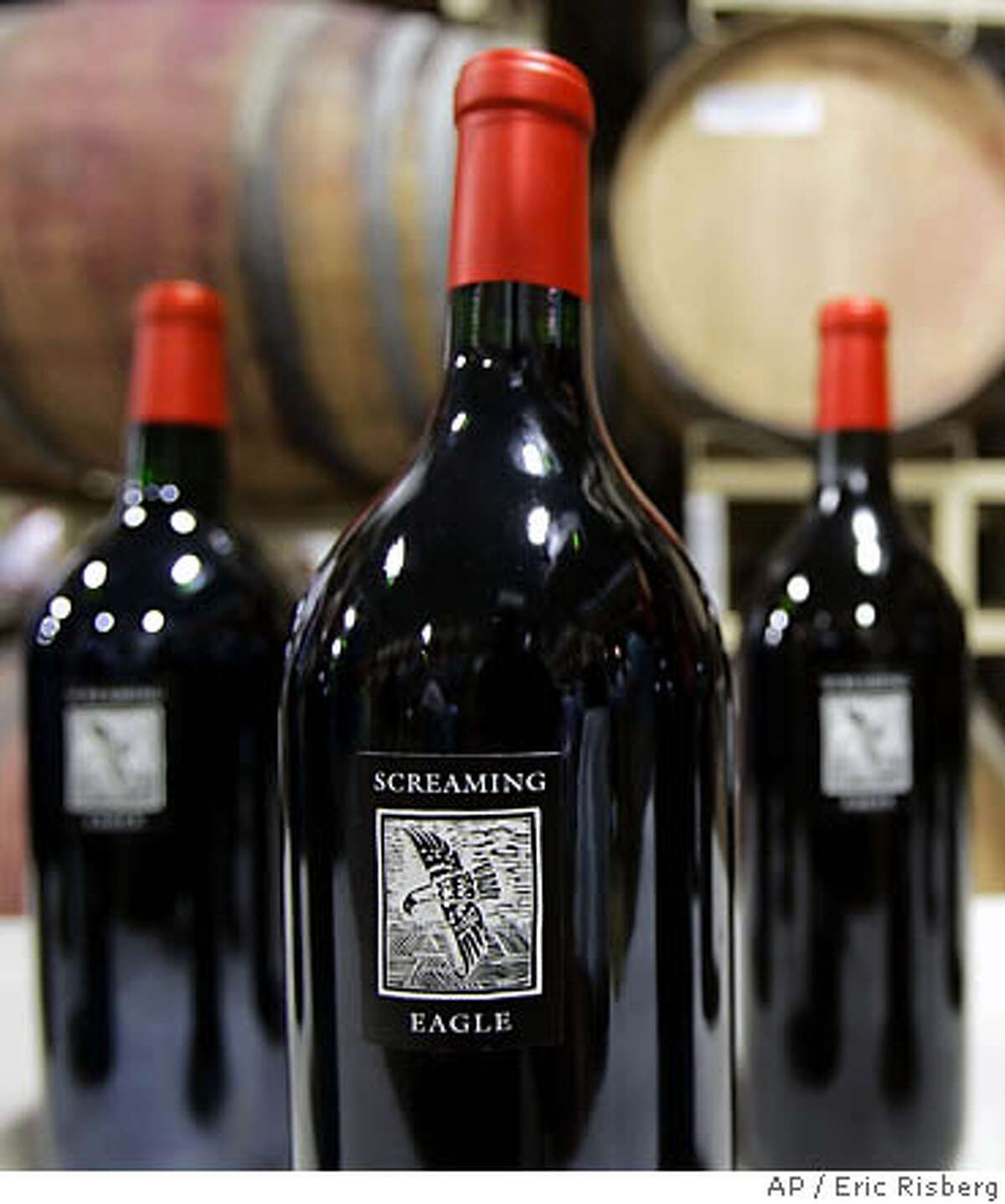 Three magnums, part of a vertical lot of 12 bottles of Screaming Eagle Cabernet Sauvignon wine are shown on display during the Napa Valley wine auction in St. Helena, Calif., Friday, June 2, 2006. The three-day event, featuring a barrel auction, an online auction and the centerpiece live auction Saturday night, raised $8.4 million in all, organizers said. (AP Photo/Eric Risberg) Ran on: 06-08-2006 Joy Craft (far right) paid $1.05 million at Auction Napa Valley for a lot arranged by Shari and Garen Staglin (center). Ryan Seacrest (left) emceed. Another lot included a Screaming Eagle vertical. Ran on: 06-08-2006