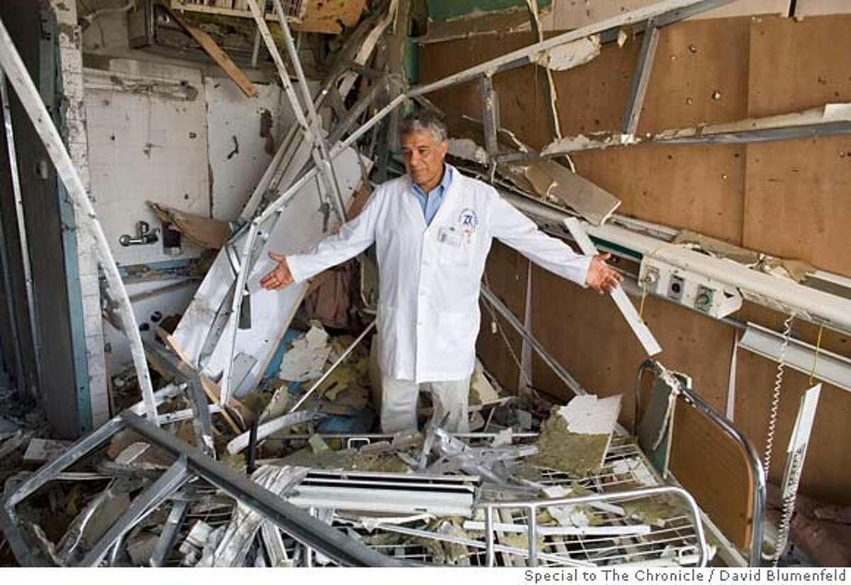 Nahariya, Israel: Dr. Uri Rehany, an Opthamologist at the Nahariya Hospital stands in the rubble of his department after it was hit by a Ketushya Rocket. �David Blumenfeld/SPECIAL TO THE CHRONICLE.