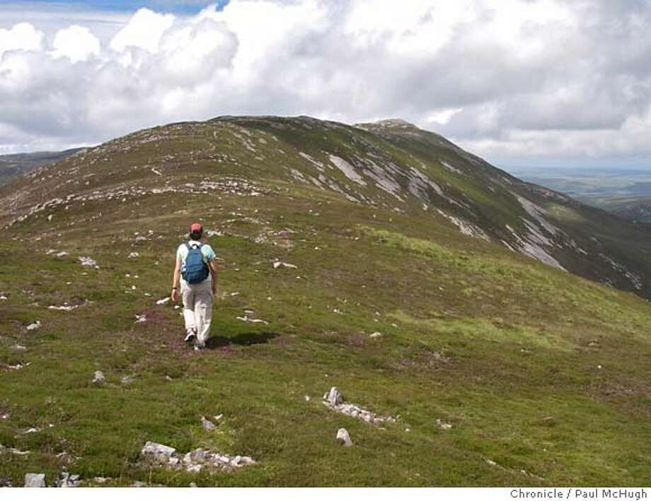 walkscotland03_PH4.jpg American hiker Dawn Garcia hikes toward the summit of Ben Vicar, the highest point on the isle of Islay in the Scottish Hebrides Islands. (Pat McHugh/The Chronicle) MANDATORY CREDIT FOR PHOTOGRAPHER AND SAN FRANCISCO CHRONICLE/ - MAGS OUT Photo: Paul McHugh