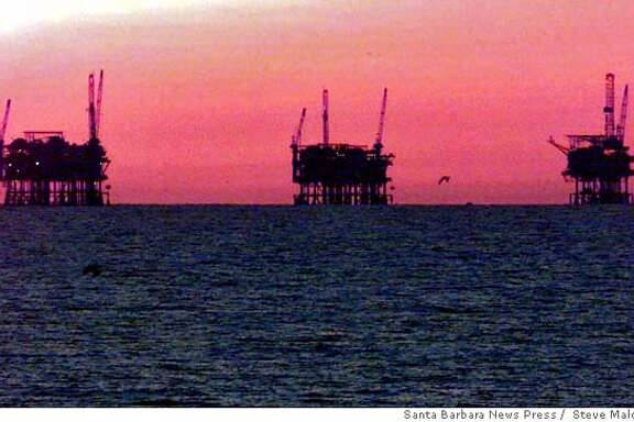 FILE---Three oil rigs on horizon in the Santa Barbara Channel from La Conchita in western Ventura County, Calif., are shown in this Dec. 7, 1998 file photo. Oil companies eager to drill their 40 offshore leases along California's coast have turned in exploration and development plans, a critical step that could mean new oil drilling within a few years, federal officials said Thursday, June 3, 1999. (AP Photo/Santa Barbara News Press, Steve Malone) ALSO RAN 2/16/02 Ran on: 08-12-2005  Lease extensions could bring new drilling platforms like these in the Santa Barbara Channel. Ran on: 08-12-2005  Lease extensions could bring new drilling platforms like these in the Santa Barbara Channel. CAT